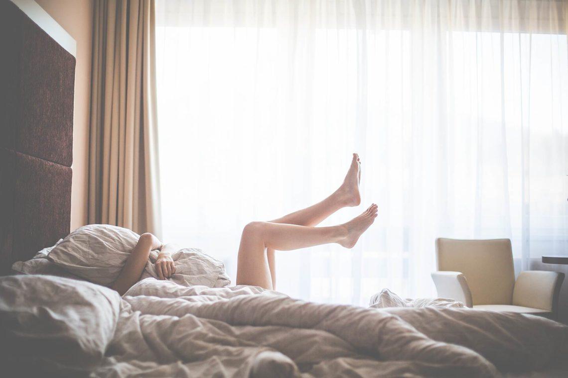 Beautiful Woman Enjoying Morning Relax in Bed